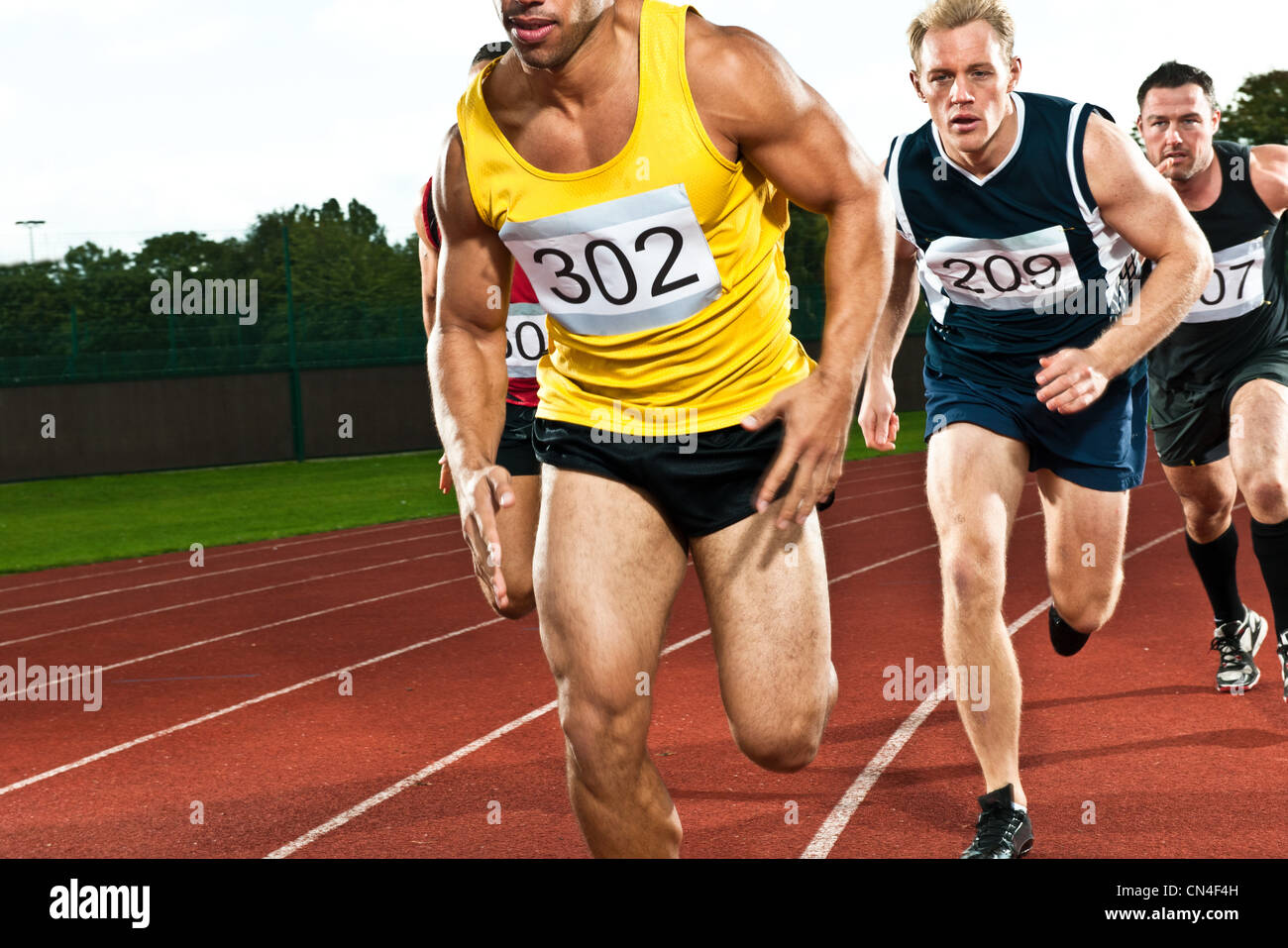 Athletes running on sportstrack - Stock Image