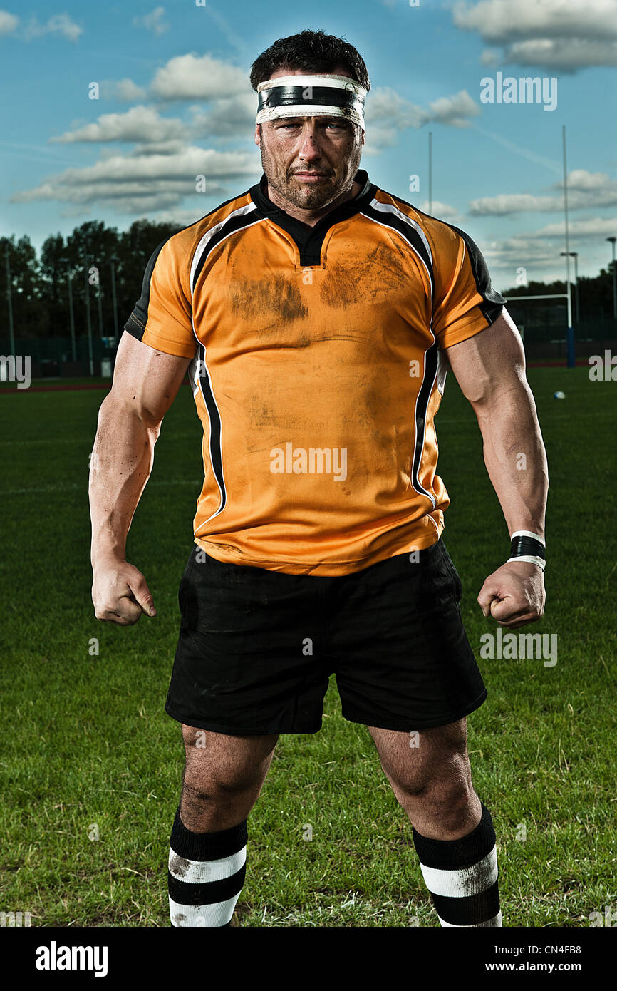 Rugby player on pitch, portrait - Stock Image