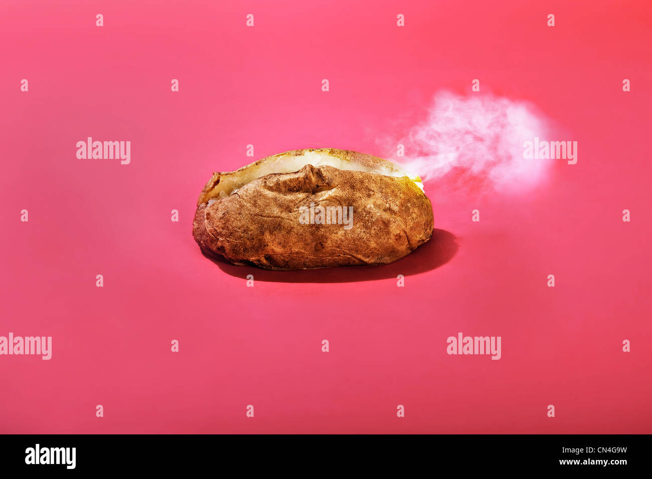 Steaming baked potato - Stock Image
