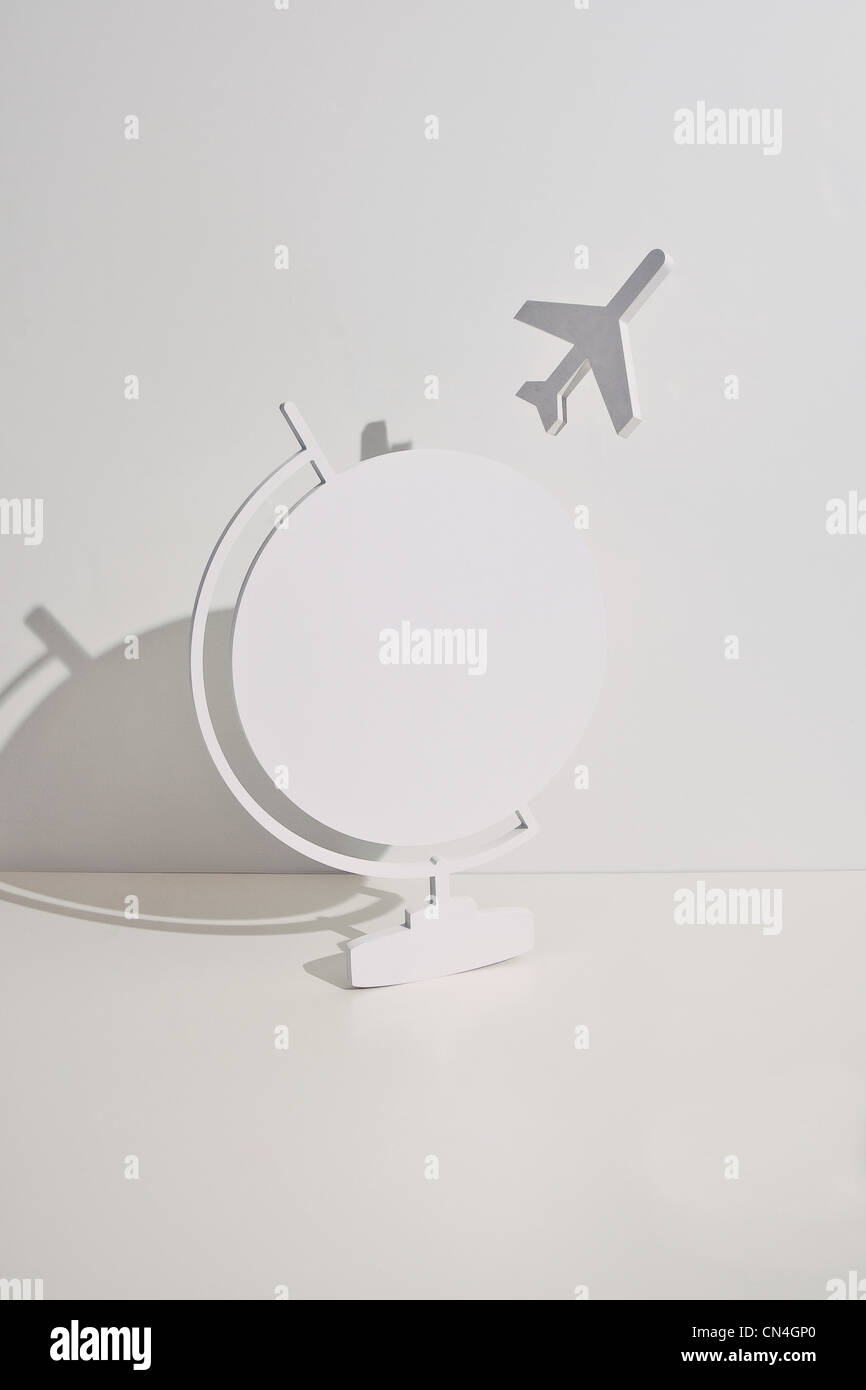 Plane taking off from globe - Stock Image