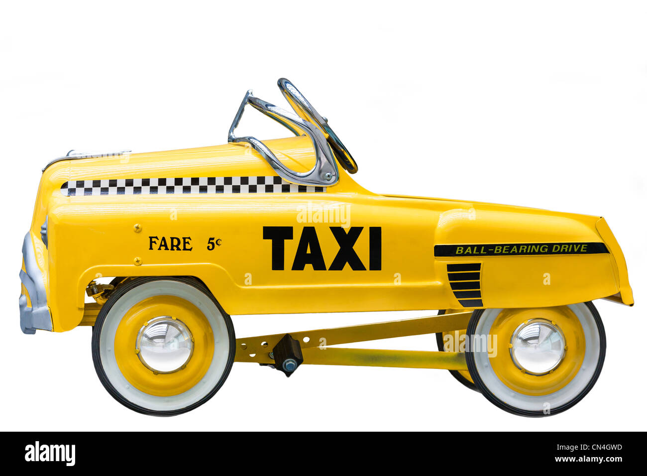 Kid's size small version of a vintage Yellow New York Taxi Cab. A push bike pedal car. Cut out isolated on white - Stock Image
