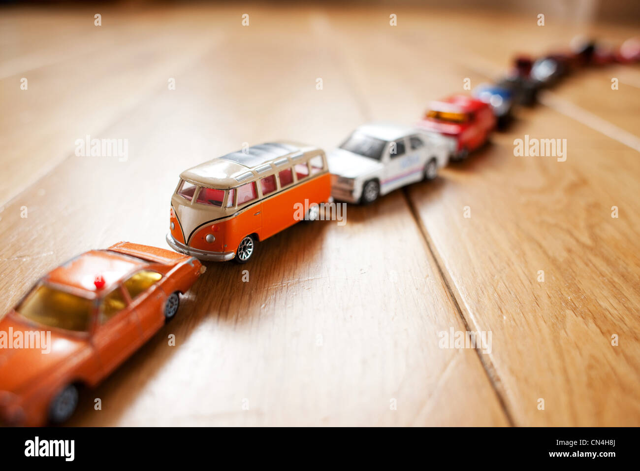 Queue of toy cars - Stock Image