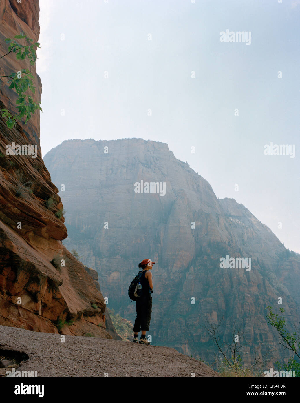 Woman at mountain overlook, Zion National Park, Utah - Stock Image