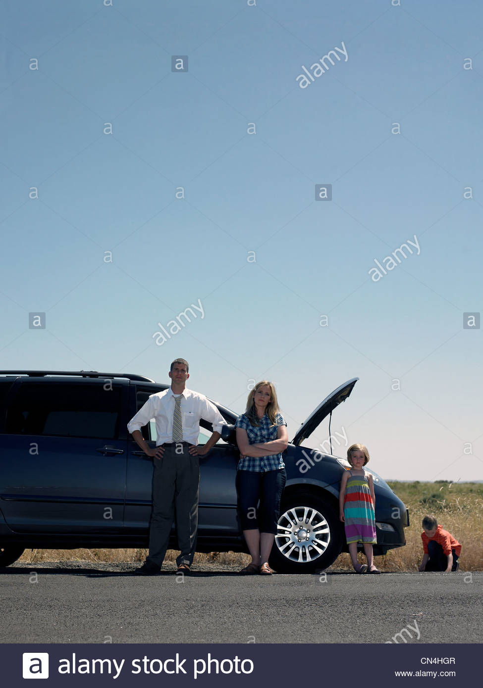 Family at roadside with broken down car - Stock Image