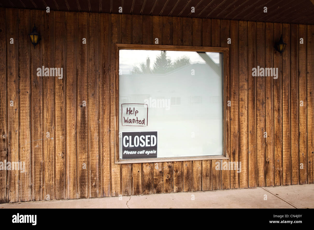Signs in shop window - Stock Image