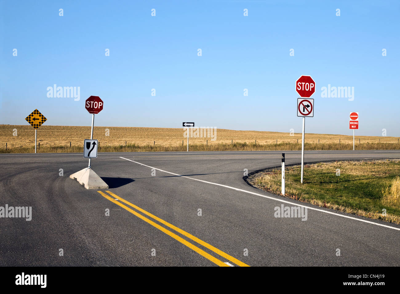 Signs on empty highway - Stock Image