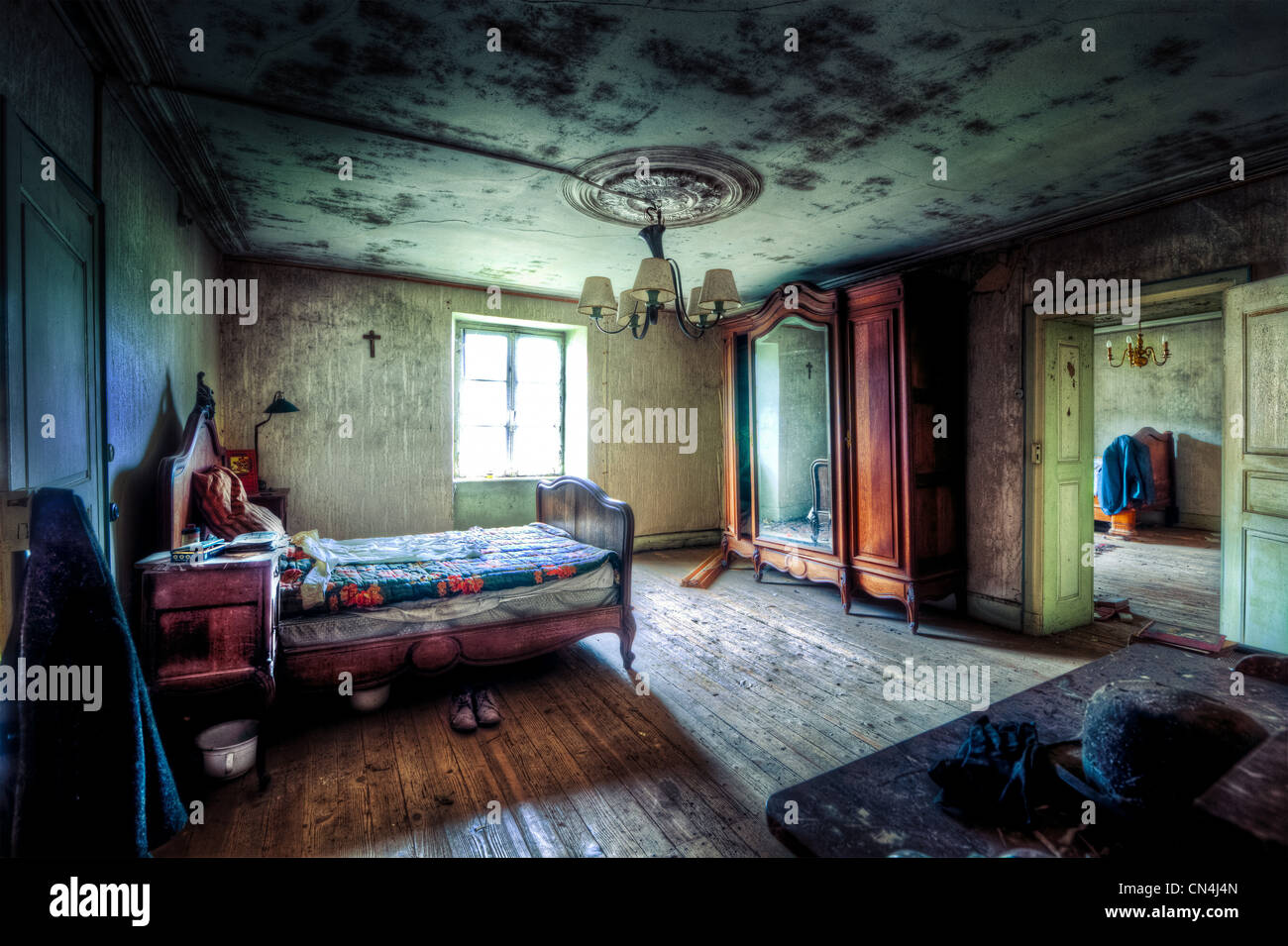 Bedroom in dilapidated house - Stock Image
