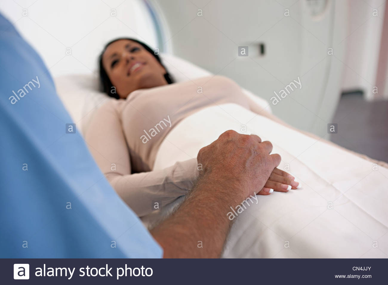 CT scan patient being reassured - Stock Image