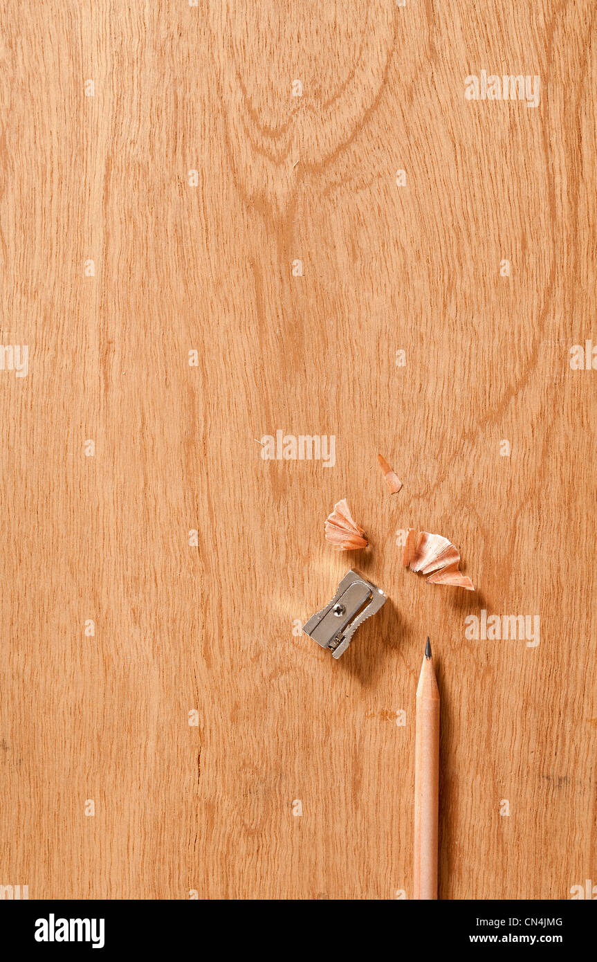 Pencil and sharpener on wooden background - Stock Image
