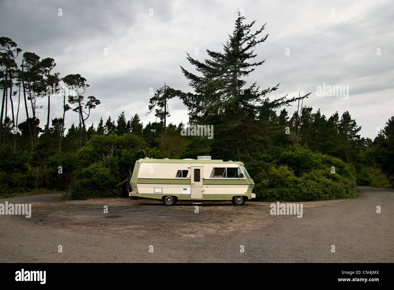 Camper van on secluded road - Stock Image