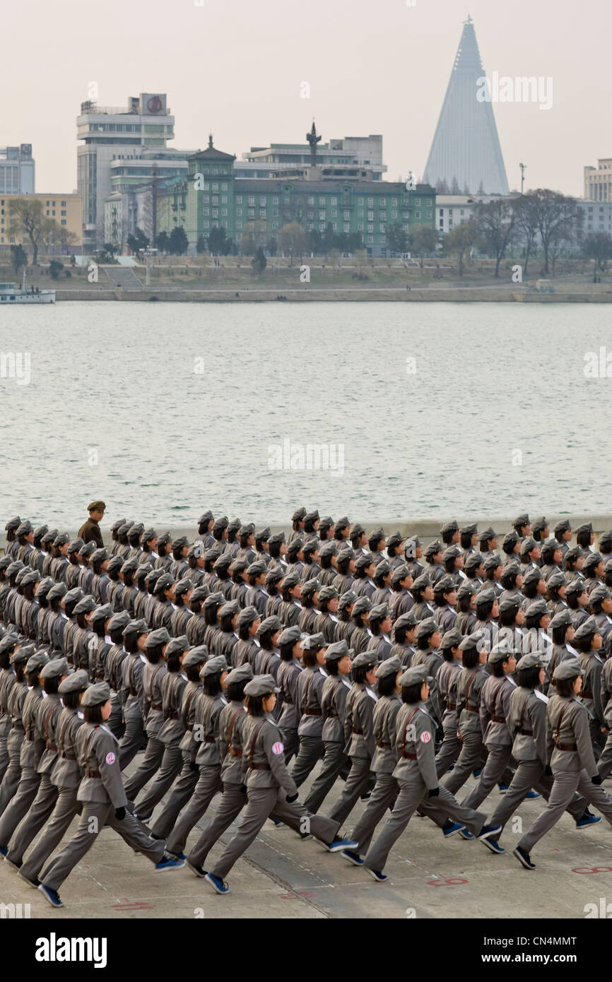 North Korea, Pyongyang, Juche tower esplanade, squad of female teenagers in military uniforms rehearsing for a parade - Stock Image