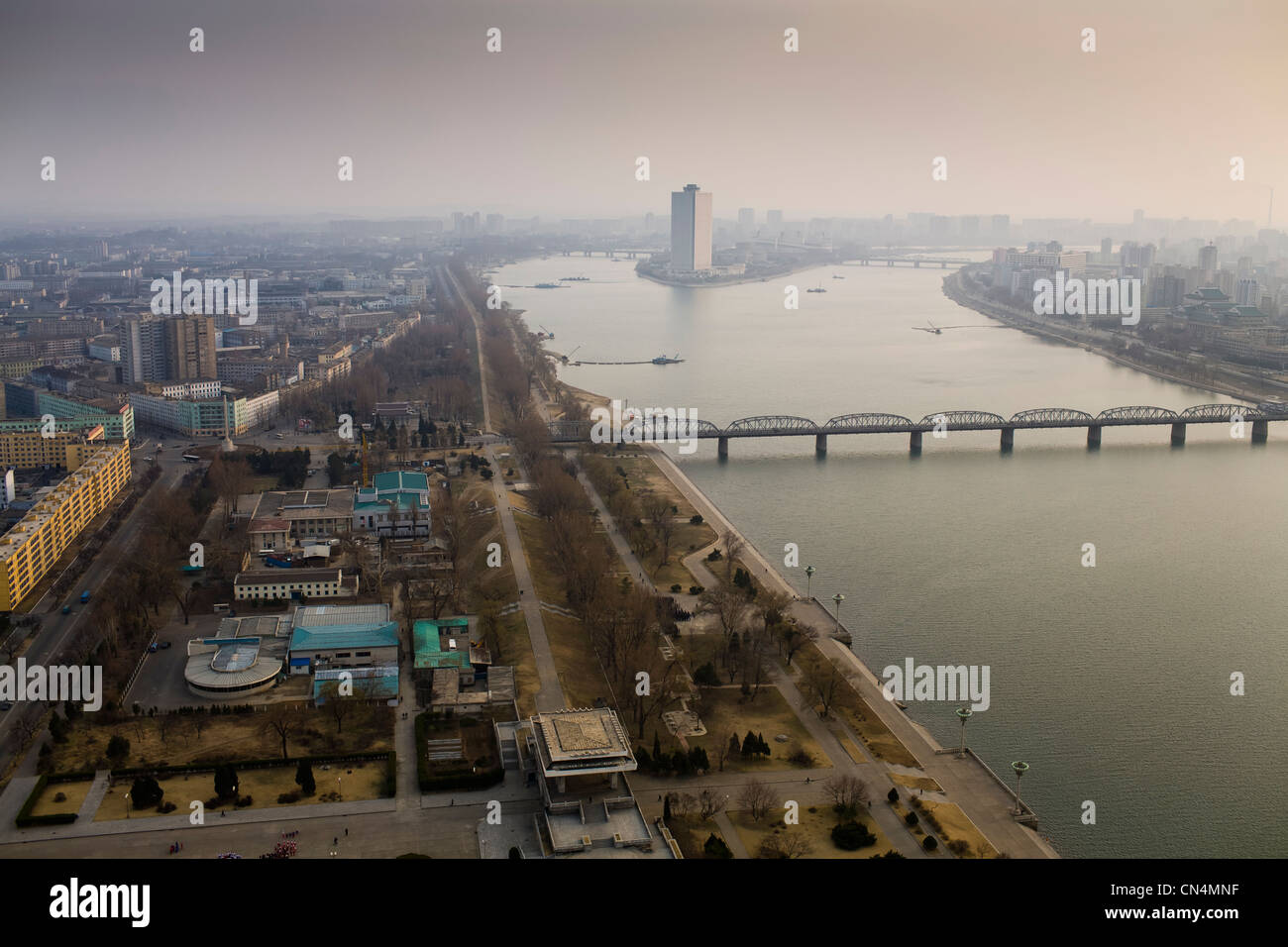 North Korea, Pyongyang, Juche tower, elevated view of the Taedong river and of Yanggak Island - Stock Image