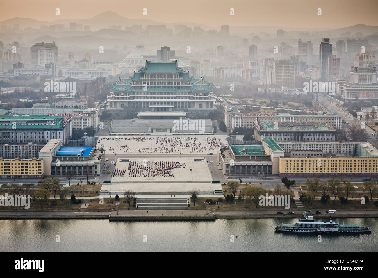 North Korea, Pyongyang, Juche tower, elevated view of Kim Il-Sung square across the Taedong river - Stock Image