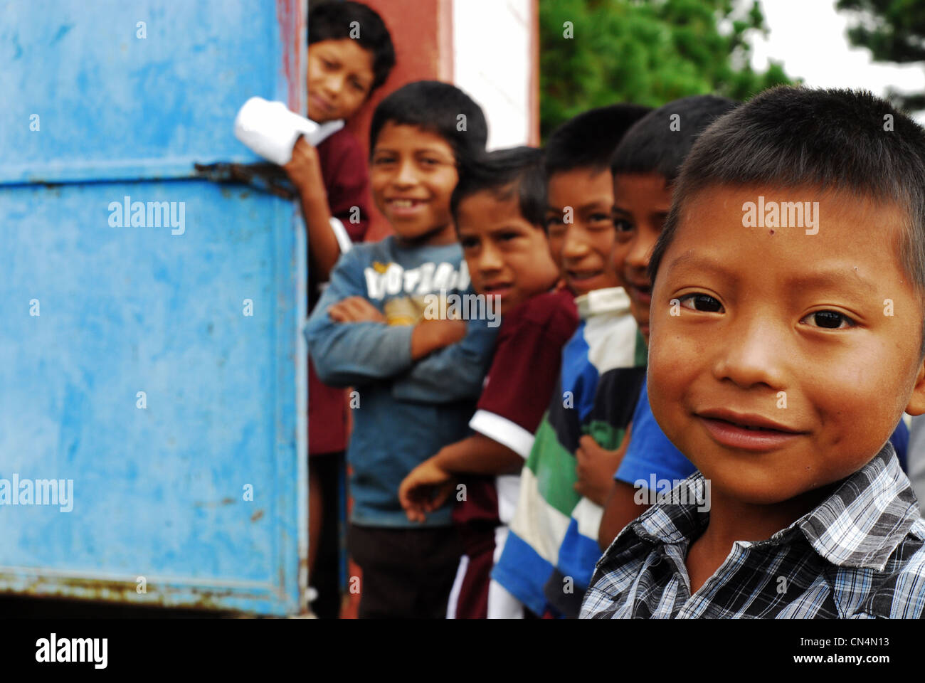 Guatemala, Aguacatan, schoolboys queuing in front of latrine, (MR) - Stock Image