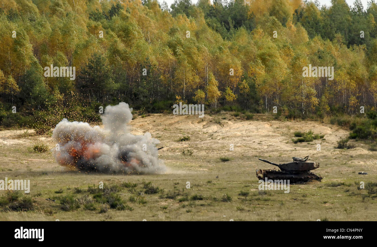 An M60 Patton tank explodes after being hit with an FGM-148 Javelin anti-tank guided missile fired by U.S. Army Stock Photo