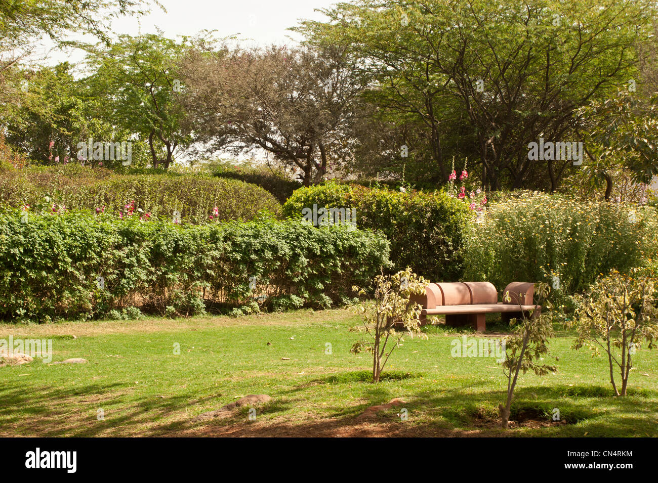 Stone Bench Inside A Garden. This Is The Garden Of 5 Senses In South Delhi  With A Large Number Of Plants, Trees And A Great Lawn