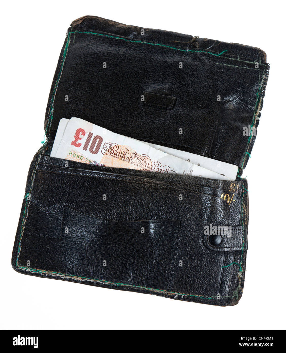 Old and worn leather wallet with ten pound notes inside, UK - Stock Image