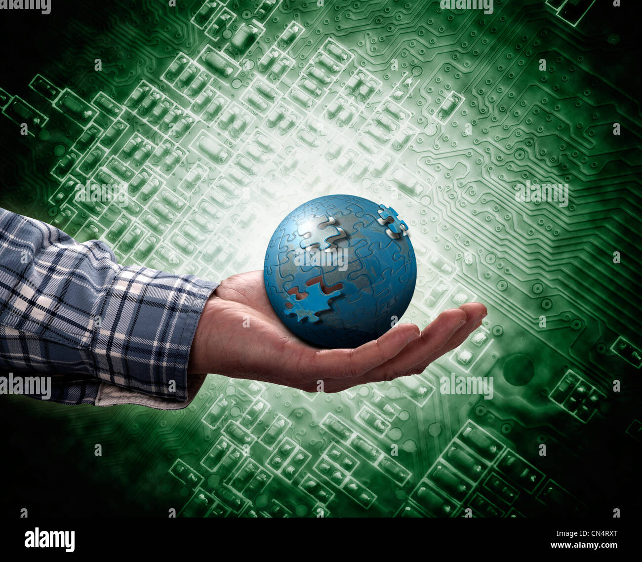 holding a glowing earth globe in his hands - Stock Image