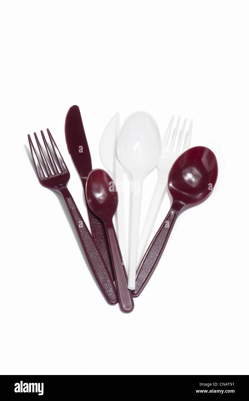 Plastic knives, forks and spoons - Stock Image