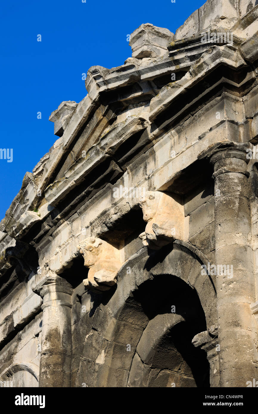 France, Gard, Nimes, the arenas, pediment ornamented with bulls over the main of the four axial gates - Stock Image