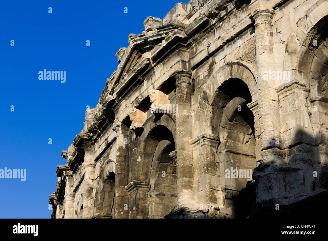 France, Gard, Nimes, the arenas, pediment ornamented with bulls over the main of the four axial gates Stock Photo