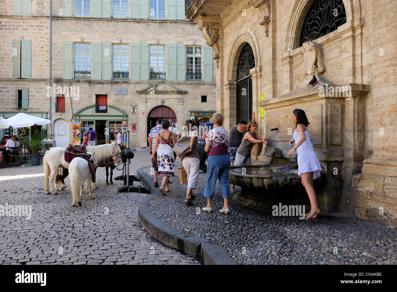 France, Herault, Pezenas, fountain of the Hotel des Consuls Place Gambetta now home for arts and crafts on the right - Stock Image