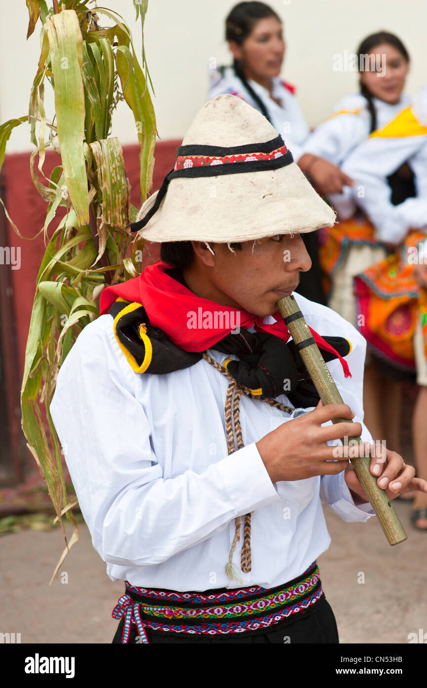 Peru, Cuzco Province, Huaro, young playing flute in traditional dress for the corn feast, Sara Raymi - Stock Image