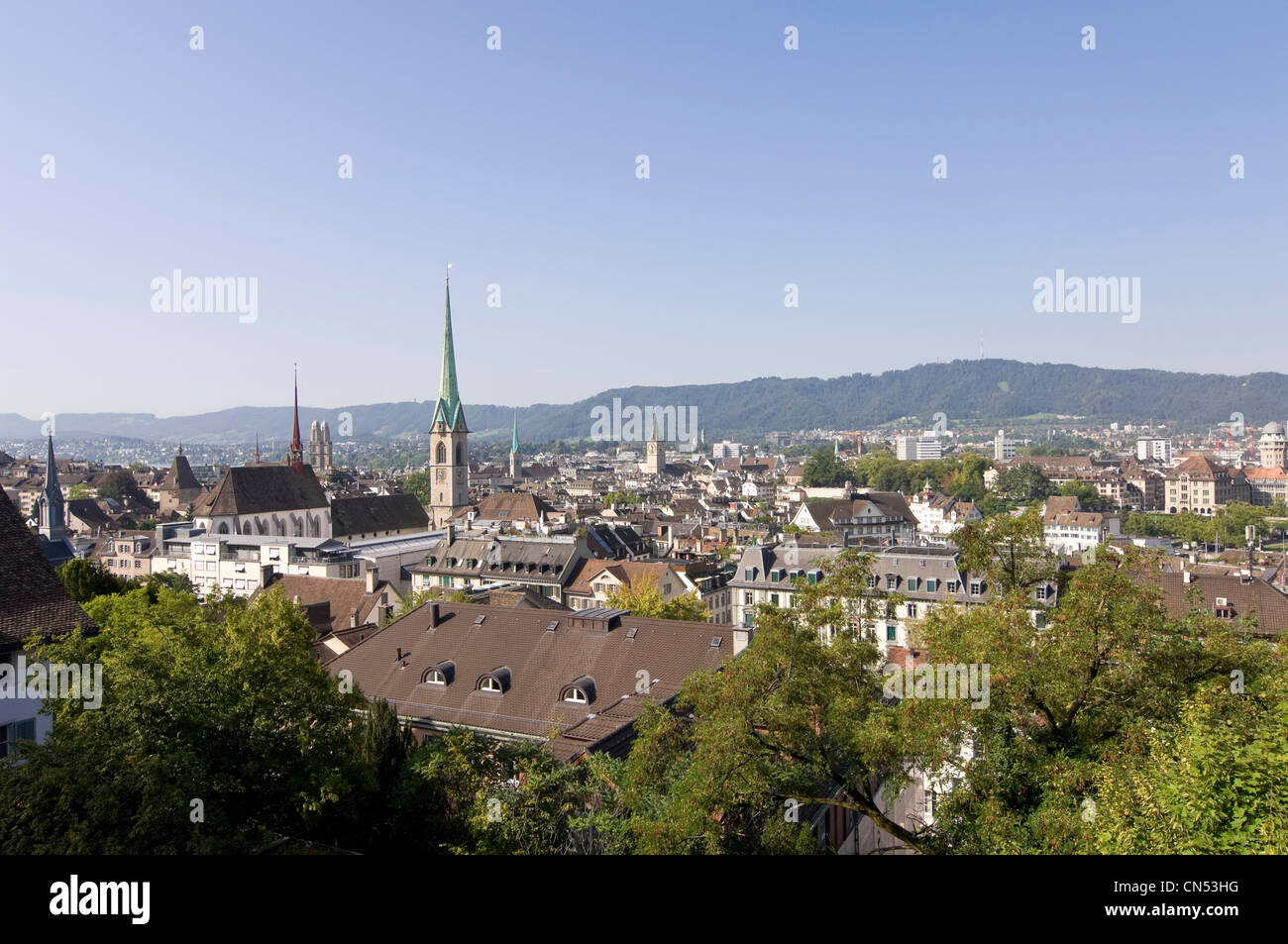 Horizontal wide angle over Zürich's skyline with Predigerkirche, Fraumünster kirche, St Peter kirche - Stock Image
