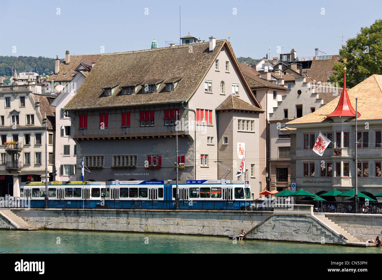 Horizontal view of the Rathaus quarter of Zurich's altstadt with the old historical building Zunfthaus zum Rüden - Stock Image