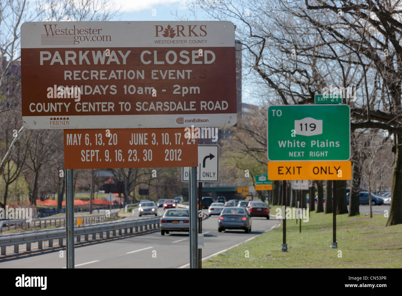 A sign shows the dates of Bicycle Sundays, when the Bronx River Parkway is closed to vehicles in White Plains, New - Stock Image