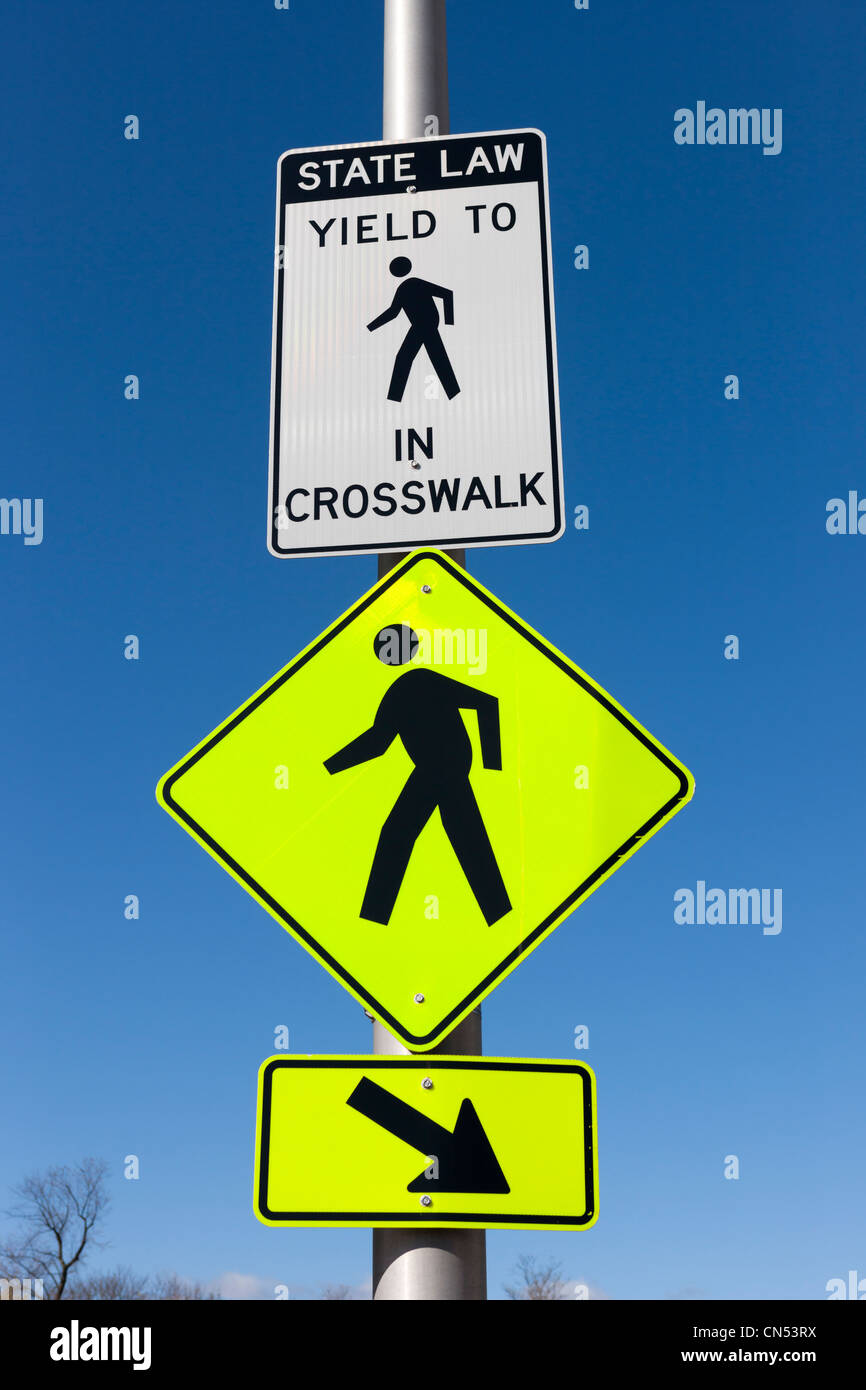 Signs indicating a crosswalk in New York. - Stock Image