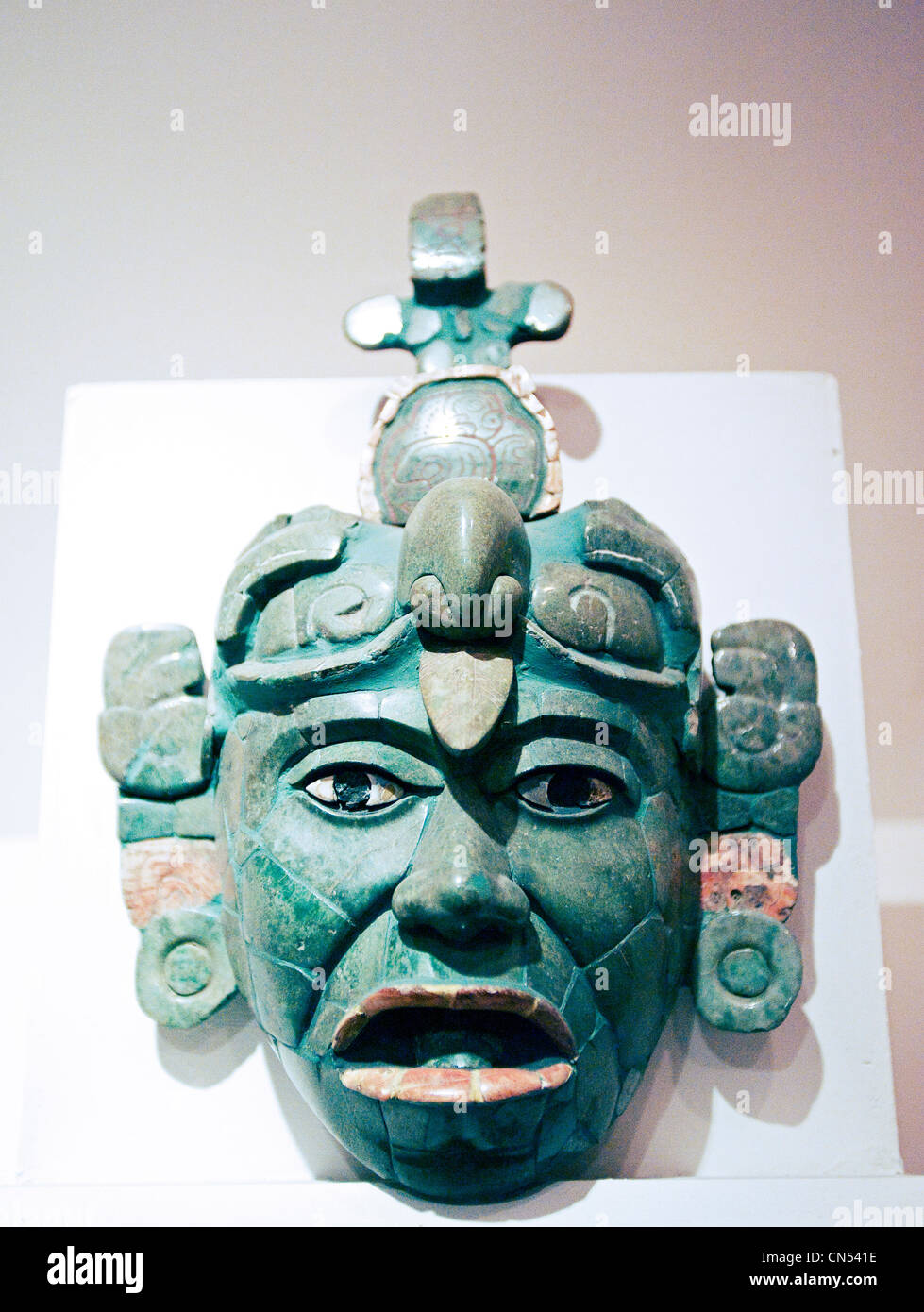 A jade mask from Tikal on display in Guatemala City's National Archaeology Museum. - Stock Image