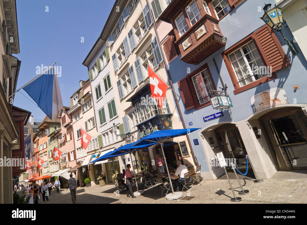 Horizontal wide angle cityscape of Augustinergasse, a popular pedestrianised street in Lindenhof in Zurich on a - Stock Image