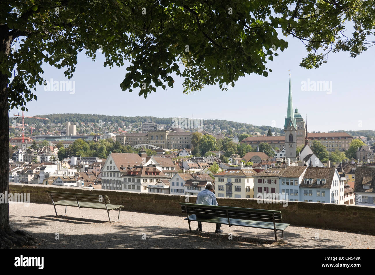 Horizontal wide angle of the view from Lindenhof hill with Predigerkirche, Preachers Church spire prominent on the - Stock Image