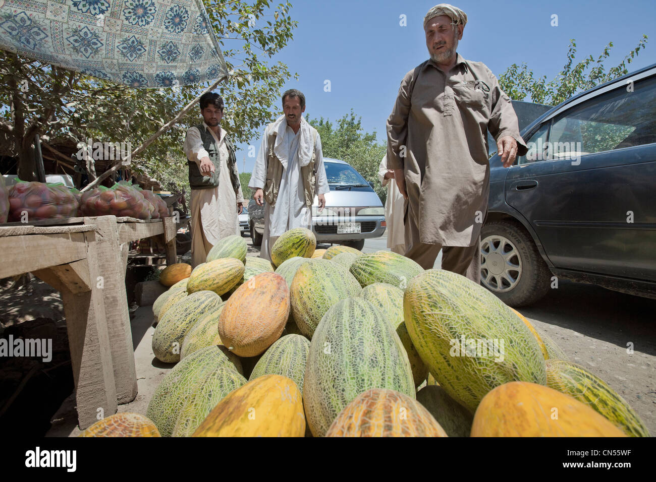 Afghanistan, Kunduz province, Aliabad, melon seller by the side of the road - Stock Image