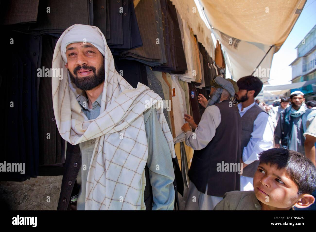Afghanistan, Kabul, Chahari Sadarat, clothes seller - Stock Image