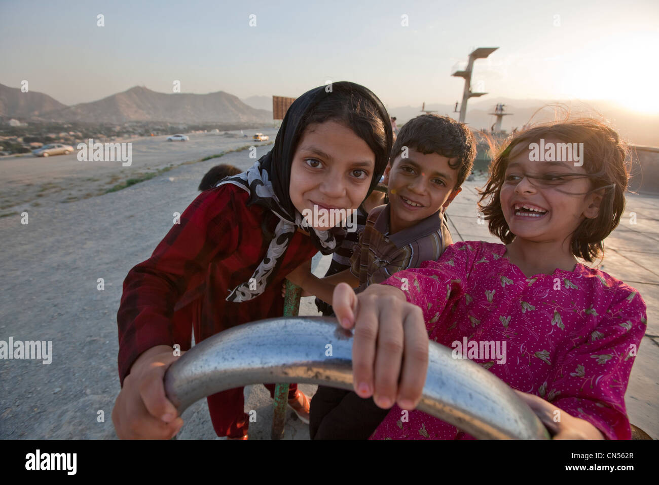 Afghanistan, Kabul, Bibi Maru Hill, young girls playing in an abandonned swimming pool - Stock Image