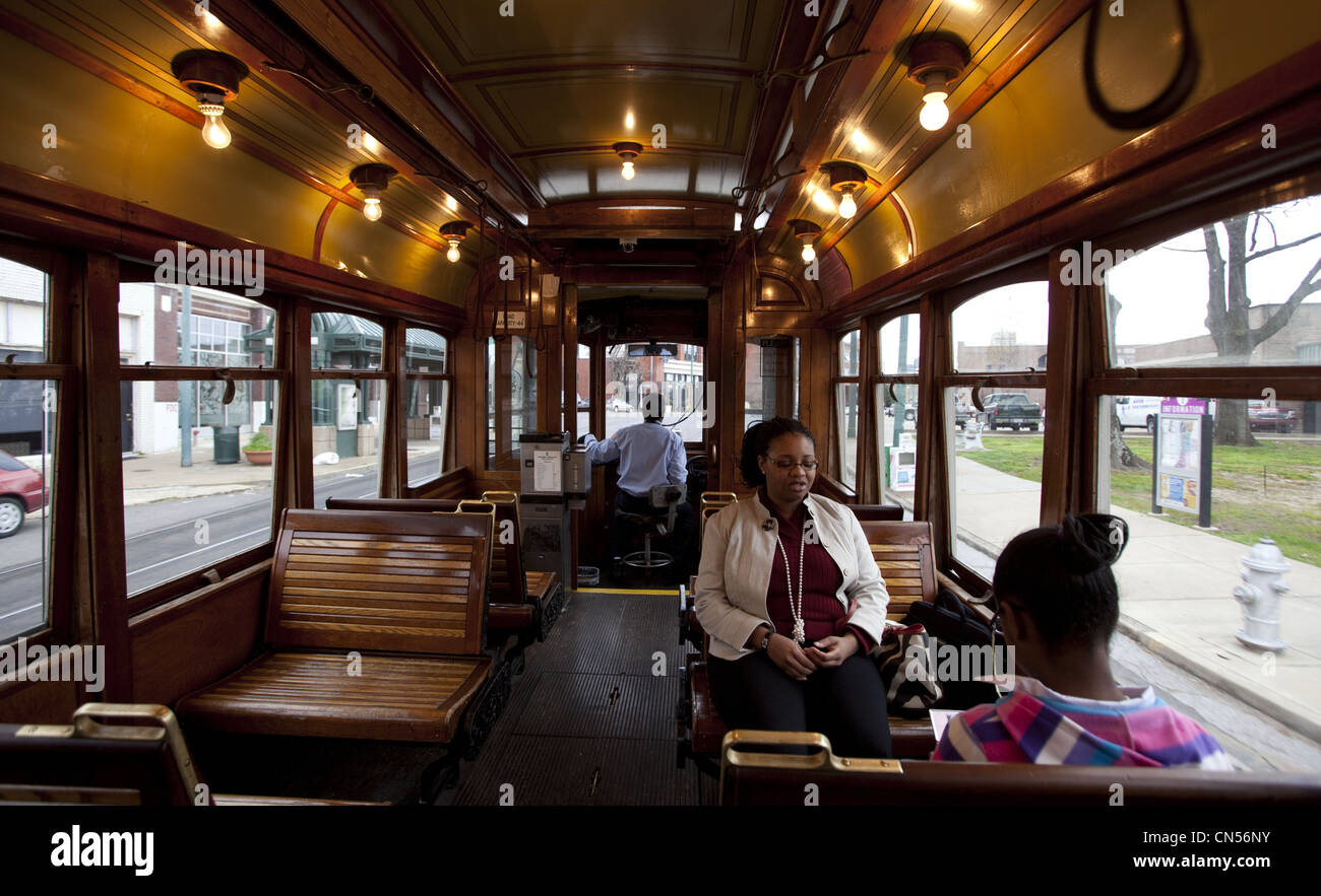 Passengers riding inside a vintage trolley car in Memphis, Tennessee - Stock Image