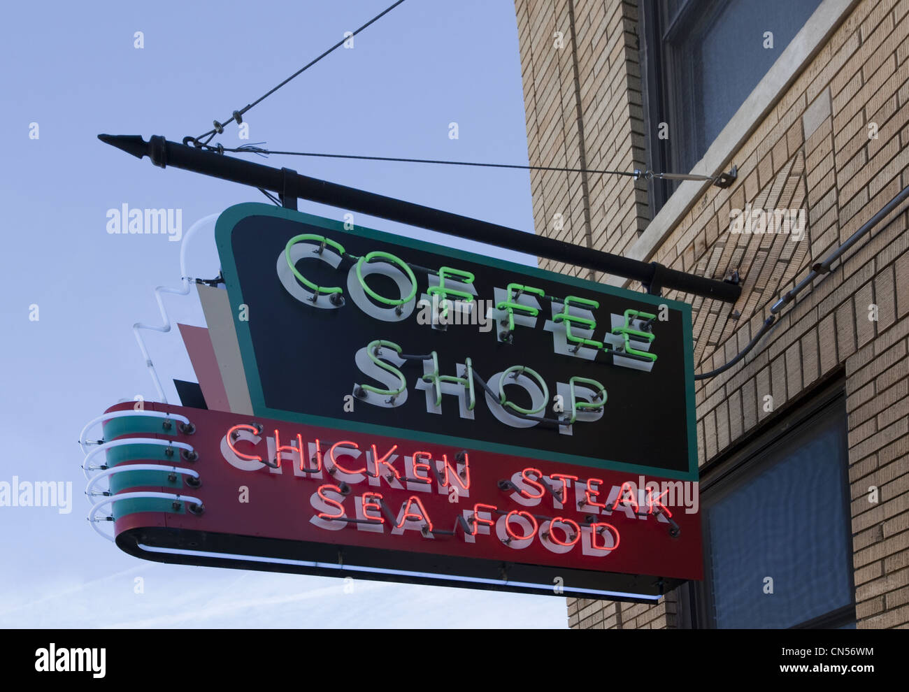 A vintage coffee shop neon sign advertising menu items of chicken, steak, and seafood at the historic site of the Lorraine Hotel Stock Photo