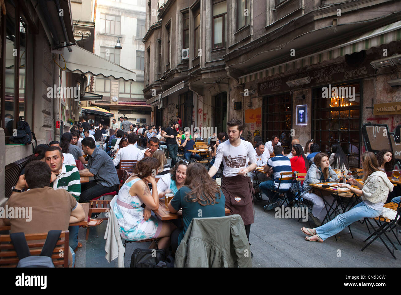 Turkey, Istanbul, Beyoglu, Tünel district, cafes, bars and restaurants in the narrow streets around Istiklal - Stock Image