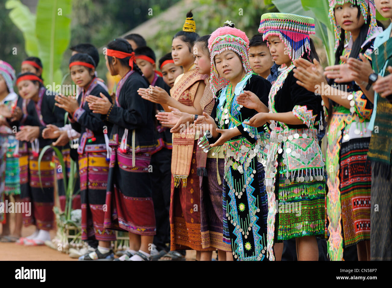 Laos, Sainyabuli Province, Hongsa, string of women in traditional costume at a ceremony - Stock Image