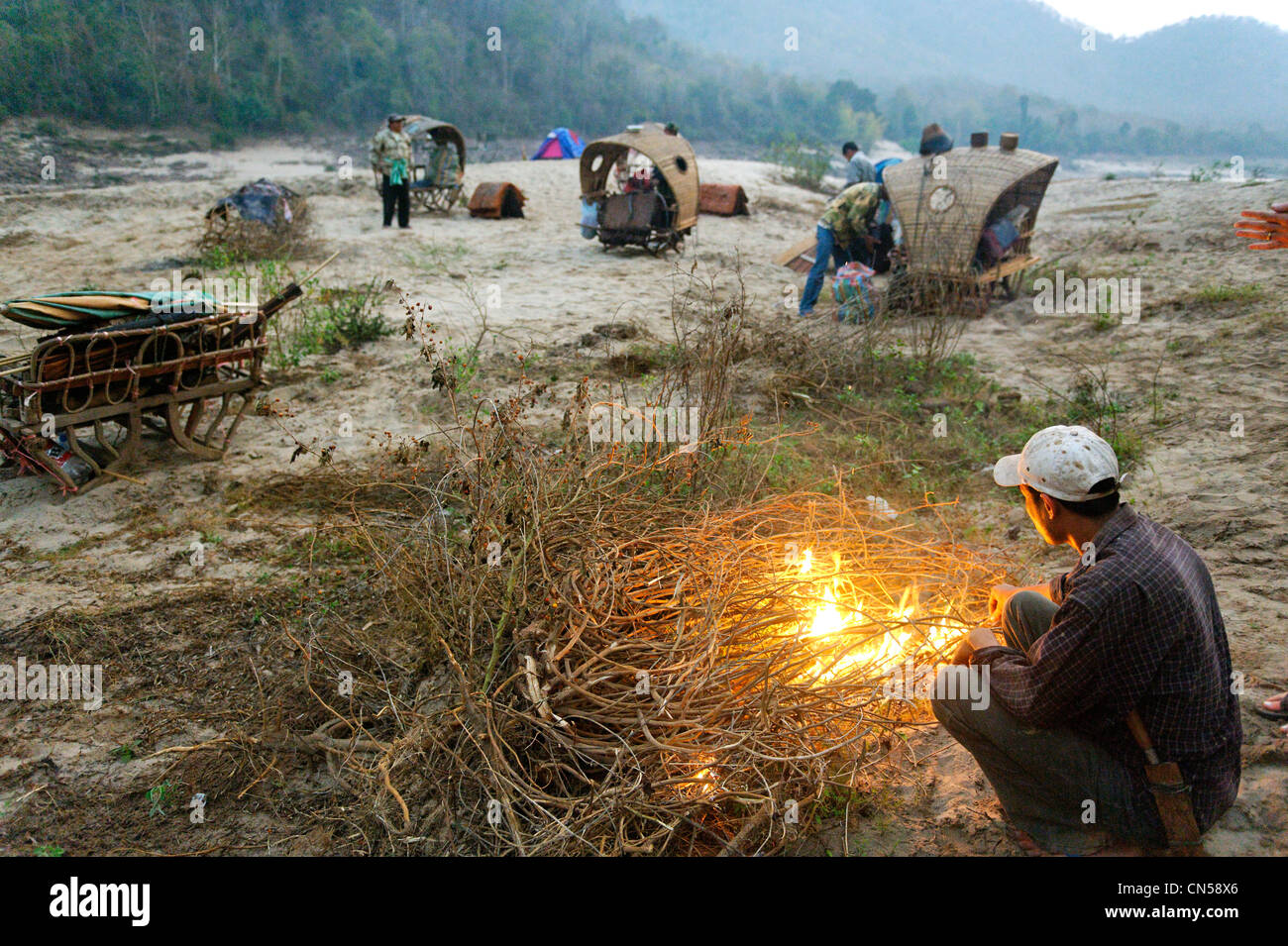 Laos, Sainyabuli Province, Mekong River, trek on elephants, mahouts and camp, preparing for departure palanquins - Stock Image