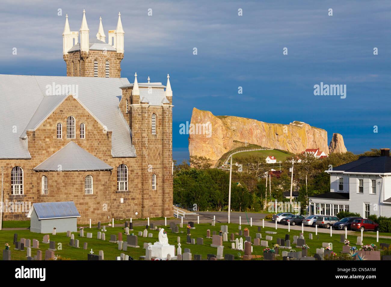 Canada, Quebec Province, Gaspe Peninsula, Perce and its famous Rocher Perce (Perce Rock), St Michel church - Stock Image