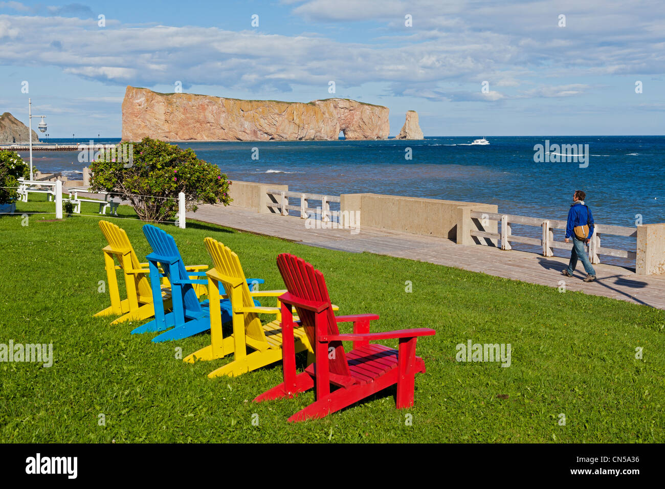 Canada, Quebec Province, Gaspe Peninsula, Perce and its famous Rocher Perce (Perce Rock), Adirondack style chairs - Stock Image