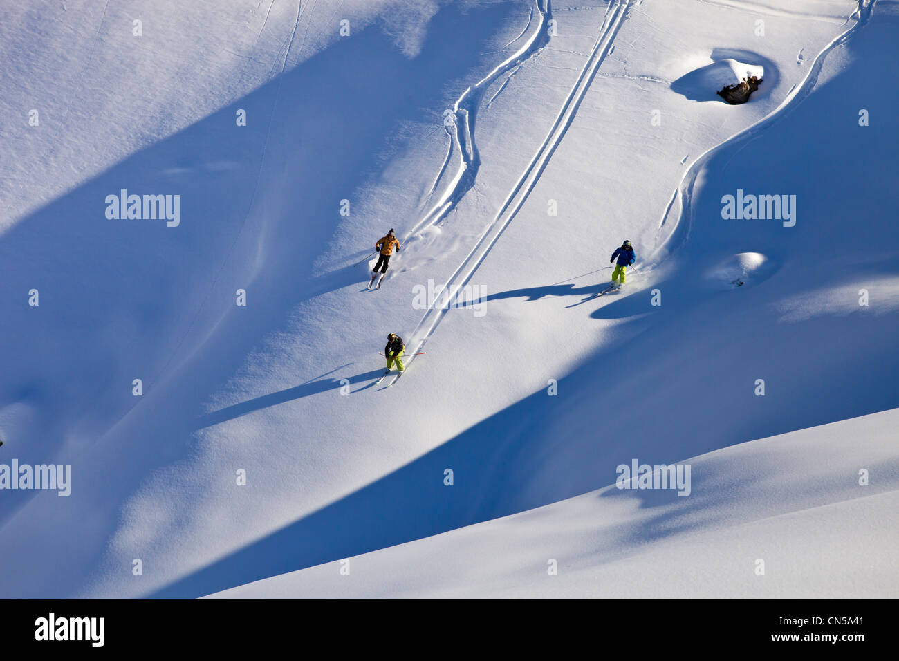 France, Savoie, Massif de La Vanoise, La Tarentaise Valley, Valmorel, teenager off-piste skiing in powder snow - Stock Image