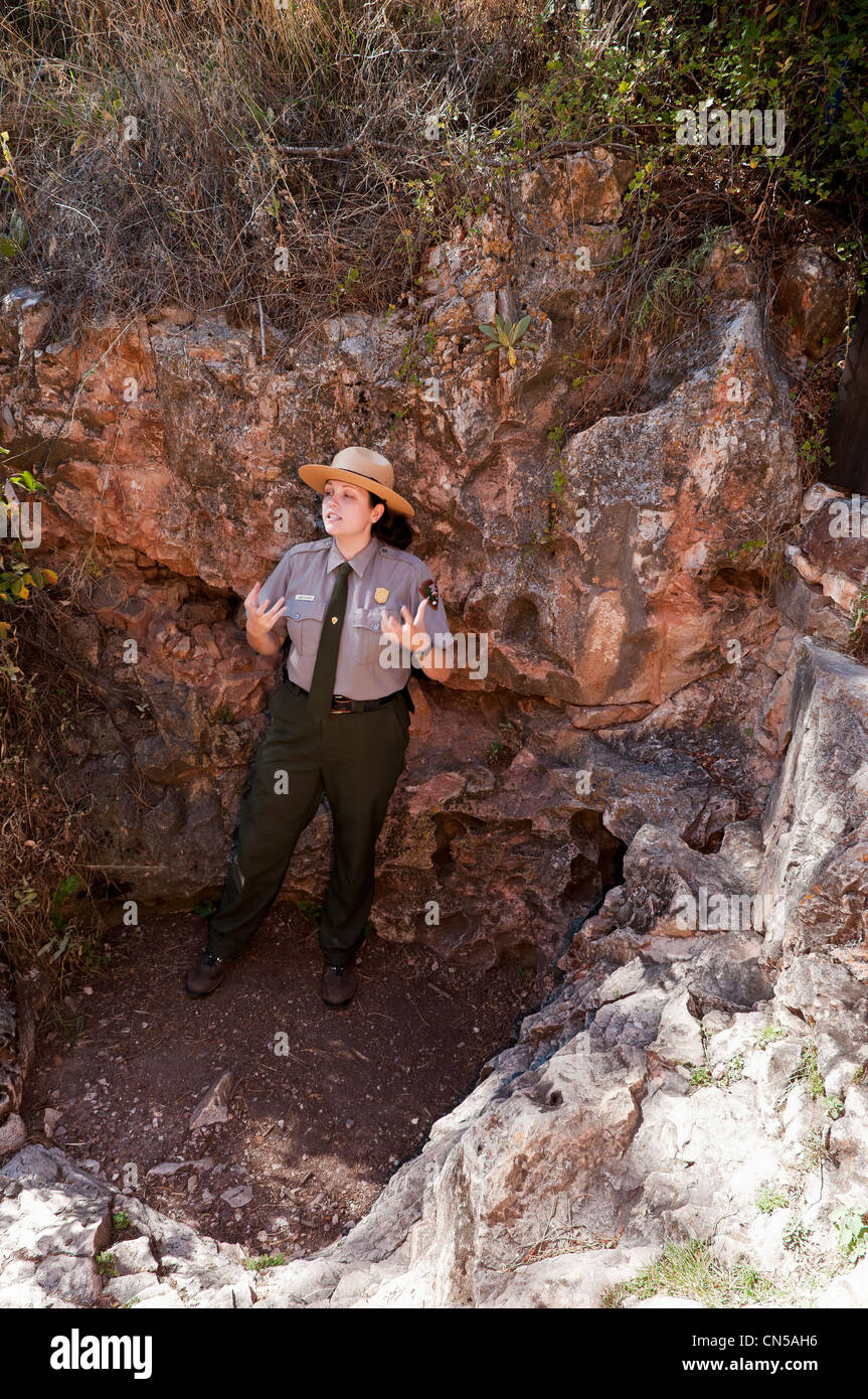Ranger at natural entrance to cave, Wind Cave National Park, Black Hills, South Dakota. - Stock Image