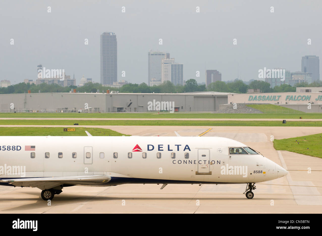 Delta Connections flight at the Little Rock National Airport, Arkansas - Stock Image