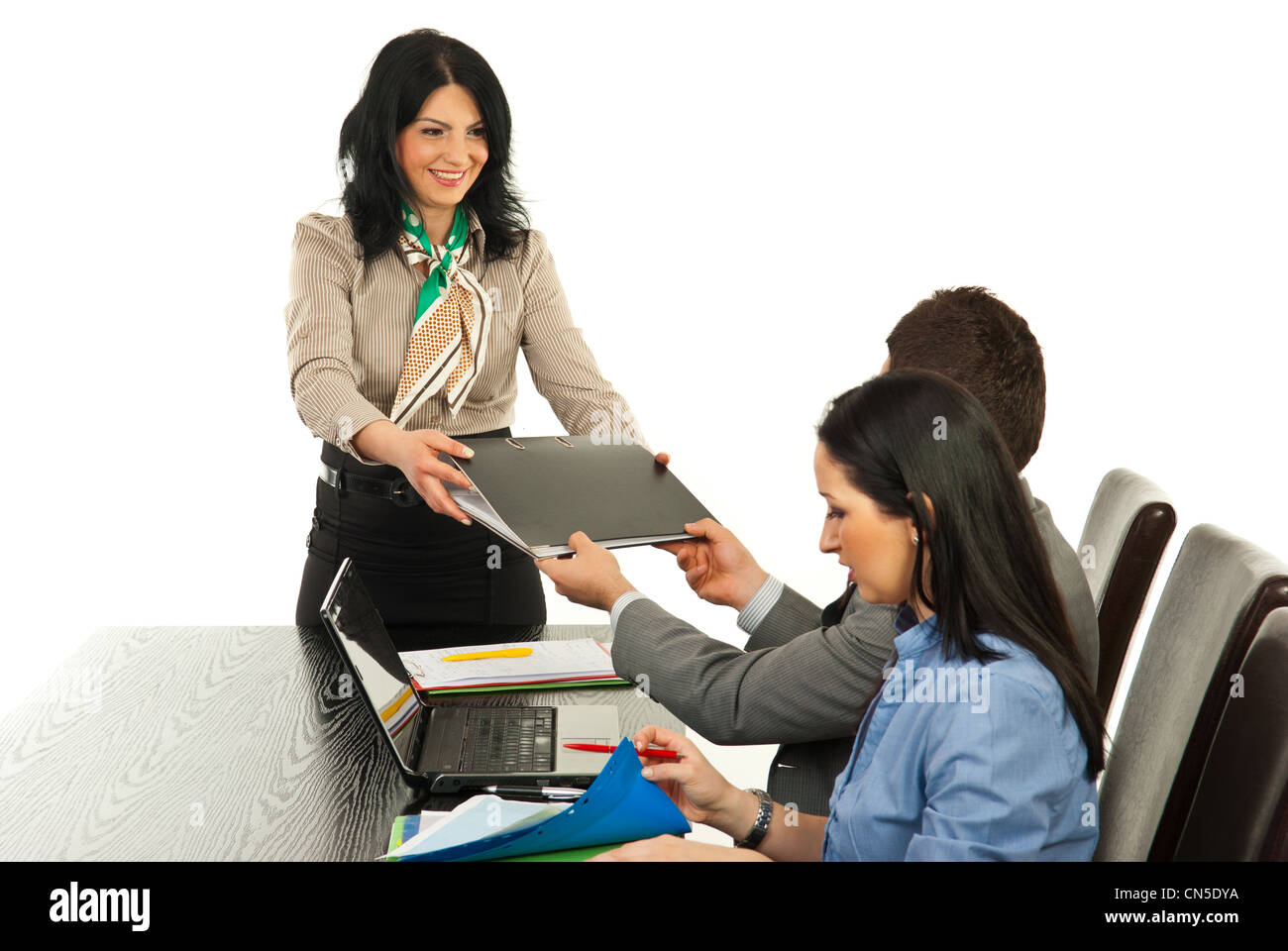 Happy manager woman giving folder to executive man at meeting against white background Stock Photo