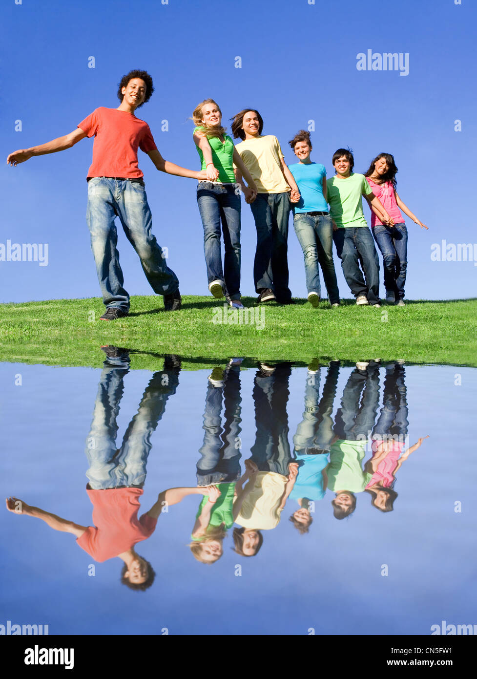 happy group of diverse teens at summer camp - Stock Image