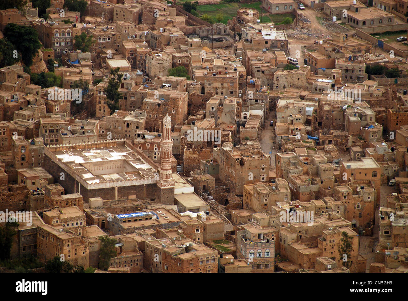 Yemen, Highlands Region, Sanaa Governorate, Kawkaban, elevated view of congested residential houses trees in background - Stock Image
